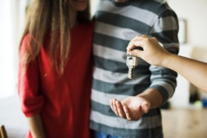 couple waiting for a key Buying your first apartment in Canada