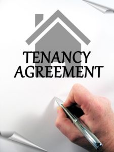 Signing a tenancy agreement for renting out a spare room.