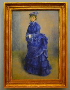 A painting in frame, a woman in a blue dress.